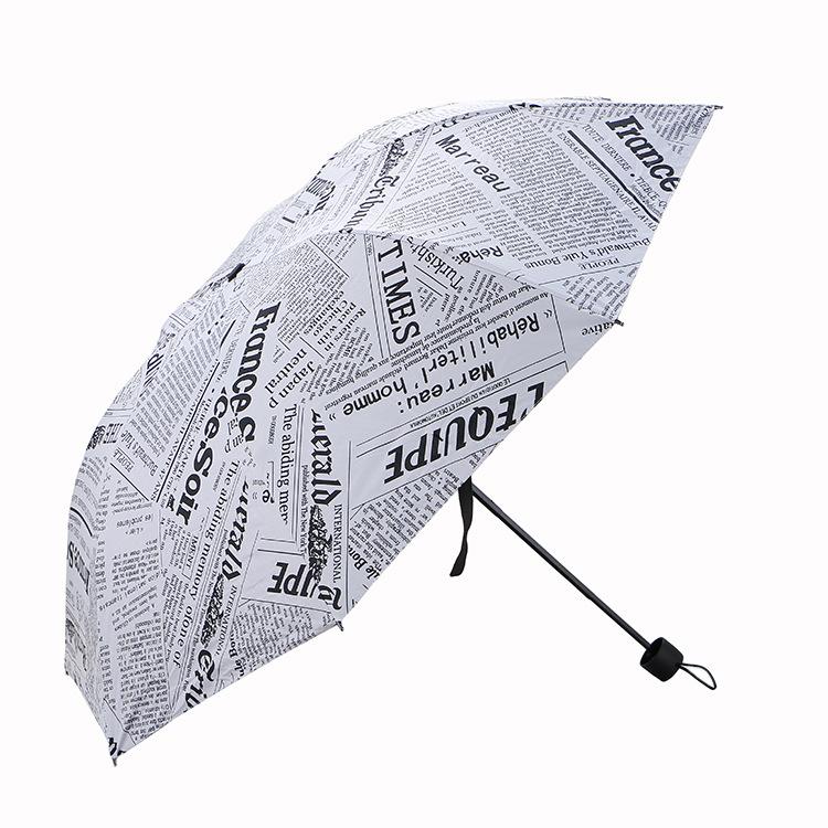 Cây dù giấy báo che mưa