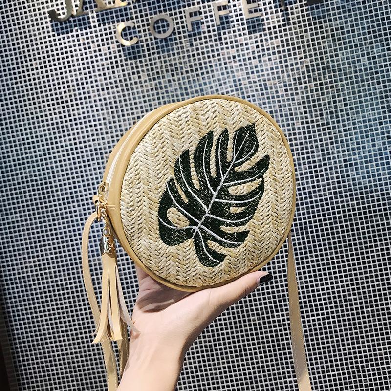 Túi xách rơm thêu hình tròn